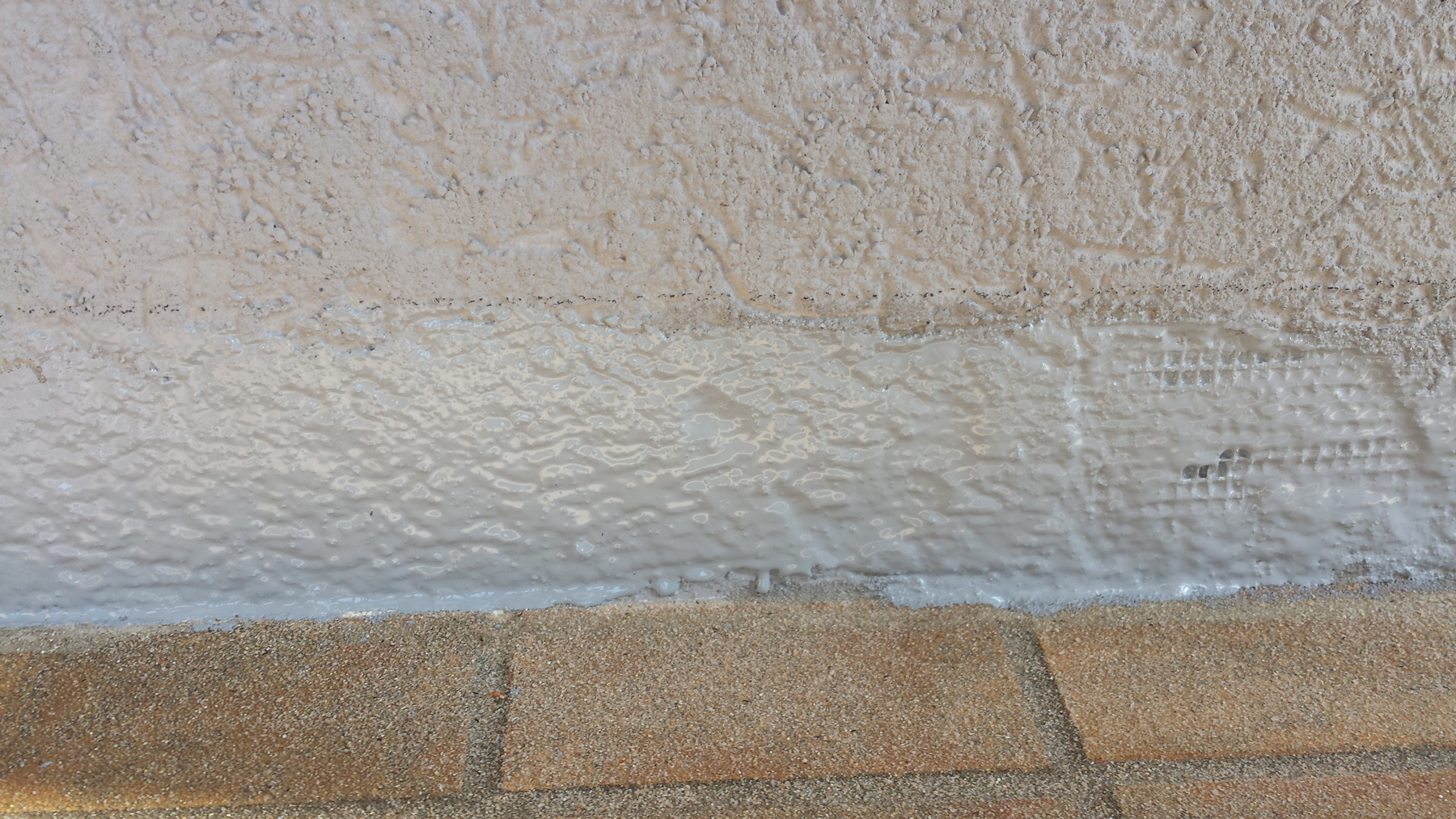 troesch - moquette pierre entrée maison - 01